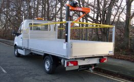 Aluminium dropside body with rails and rear crane