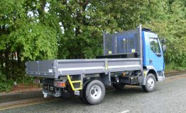 Steel front end tipping body with rear barn doors